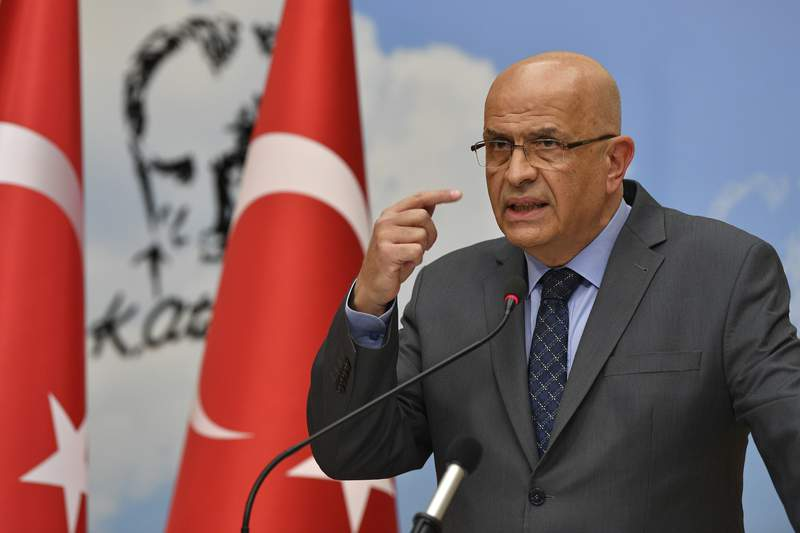 Enis Berberoglu, a legislator of Turkey's main opposition Republican People's Party, or CHP, speaks at a news conference in Ankara, Turkey, Thursday, June 4, 2020.  Turkey's parliament on Thursday stripped three opposition party deputies, including Berberoglu, of their legislative seats, setting off a raucous protest inside the assembly hall by colleagues who accused the ruling party of an assault on democracy. (AP Photo)