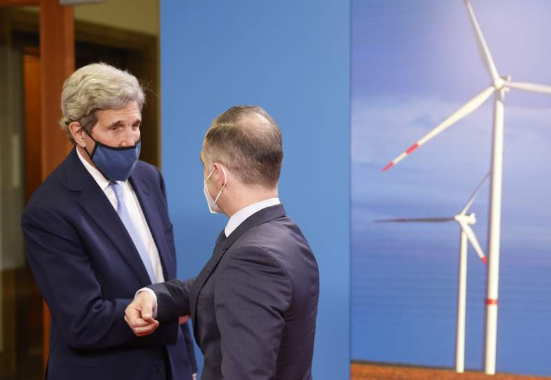 German Foreign Minister Heiko Maas, right, and the US' Special Presidential Envoy for Climate John Kerry, left, shake hands prior to a meeting at the Foreign Office in Berlin on Tuesday, May 18, 2021. (Odd Andersen/Pool Photo via AP)