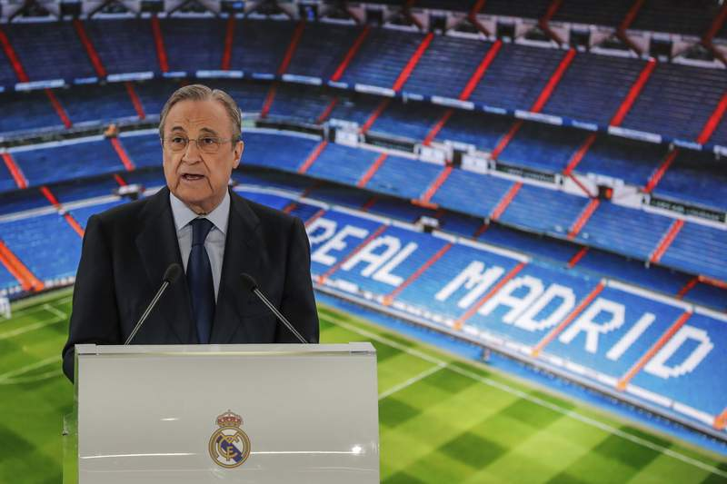 """FILE - In this June 13, 2019 file photo, Real Madrid's President Florentino Perez gives a speech at the Santiago Bernabeu stadium in Madrid, Spain. The Super League's founding chairman Florentino Perez on Tuesday, April 20, 2021 says the competition is being created to save soccer for everyone and not to make the rich clubs richer. The Real Madrid president says it's """"impossible"""" that players from the participating teams will be banned by UEFA. (AP Photo/Manu Fernandez, File)"""