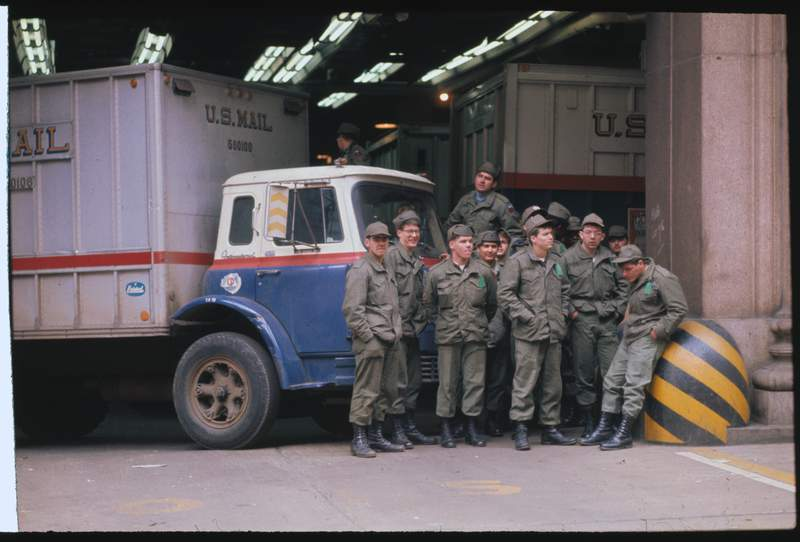 Servicemen fill in for striking postal workers at a General Post Office on March 24, 1970. Regular Army troops stand beside mail trucks after arriving at the General Post Office for duty.
