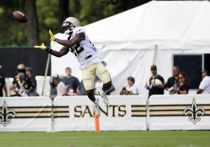 New Orleans Saints safety Chauncey Gardner-Johnson (22) catches a pass during NFL football training camp in Metairie, La., Wednesday, Aug. 4, 2021. (AP Photo/Derick Hingle)