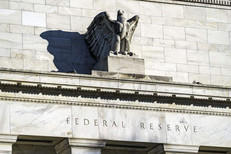 FILE - This Nov. 16, 2020, file photo, shows the Federal Reserve in Washington. The Federal Reserve said Thursday, March 25, 2021, that as of June 30 it will end for most banks the temporary limits it had imposed on their ability to make dividend payments and buy back their own stock.  (AP Photo/J. Scott Applewhite)