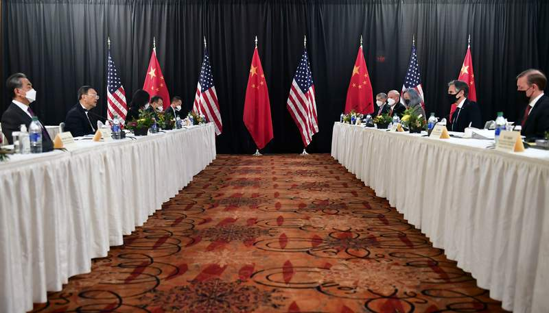 FIEL - In this March 18, 2021, file photo, Secretary of State Antony Blinken, second from right, joined by national security adviser Jake Sullivan, right, speaks while facing Chinese Communist Party foreign affairs chief Yang Jiechi, second from left, and China's State Councilor Wang Yi, left, at the opening session of U.S.-China talks at the Captain Cook Hotel in Anchorage, Alaska. China said Friday, March 19, 2021, a strong smell of gunpowder and drama resulted from talks with top American diplomats in Alaska, continuing the contentious tone of the first face-to-face meetings under the Biden administration. (Frederic J. Brown/Pool Photo via AP, File)