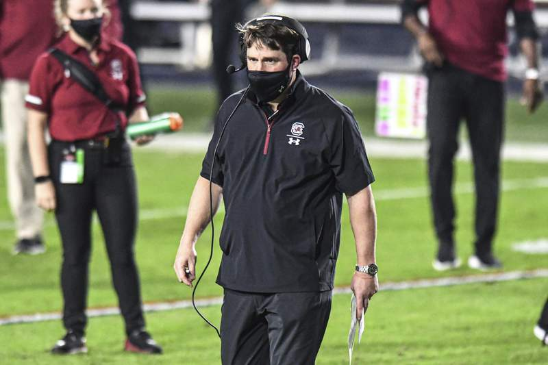 South Carolina coach Will Muschamp heads to check on an injured player during the first half of the team's NCAA college football game against Mississippi in Oxford, Miss., Saturday, Nov. 14, 2020. (AP Photo/Bruce Newman)