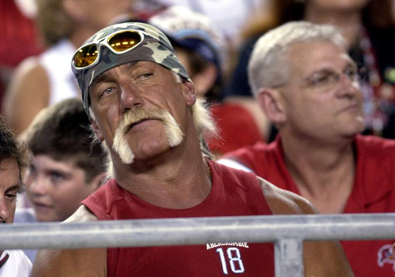 Hulk Hogan follows the play from a front-row seat in the second quarter of a preseason game between the Tampa Bay Buccaneers and the Jacksonville Jaguars, Aug. 23, 2003 at Raymond James Stadium, in Tampa.