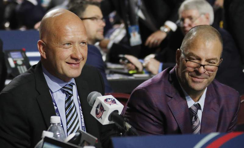Jarmo Kekäläinen (left) and Bill Zito (right) of the Columbus Blue Jackets work the 2019 NHL Draft at Rogers Arena on June 22, 2019 in Vancouver, Canada.