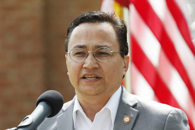 FILE - In this Aug. 22, 2019 file photo, Cherokee Nation Principal Chief Chuck Hoskin Jr., speaks during a news conference in Tahlequah, Okla. The chief of the Cherokee Nation says it's time for auto maker Jeep to stop using the tribe's name on its Cherokee and Grand Cherokee models. Chief Chuck Hoskin Jr. said in a statement he believes corporations and team sports should stop using Native American names, images and mascots on their teams and products. (AP Photo/Sue Ogrocki, File)