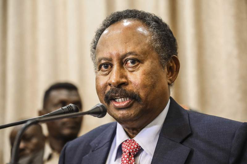 FILE - In this Aug. 21, 2019, file photo, Sudan's Prime Minister Abdalla Hamdok speaks at a news conference in Khartoum, Sudan. A statement from Hamdoks office says deadly tribal clashes between Arabs and non-Arabs in the country's South Darfur province that erupted on Tuesday, May 5, 2020, and continued into Wednesday have since subsided. (AP Photo, File)