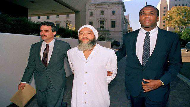 Hulon Mitchell Jr., also known as Yahweh ben Yahweh, is led into the federal courthouse in New Orleans by FBI agents, Nov. 7, 1990, after his arrest on racketeering charges.