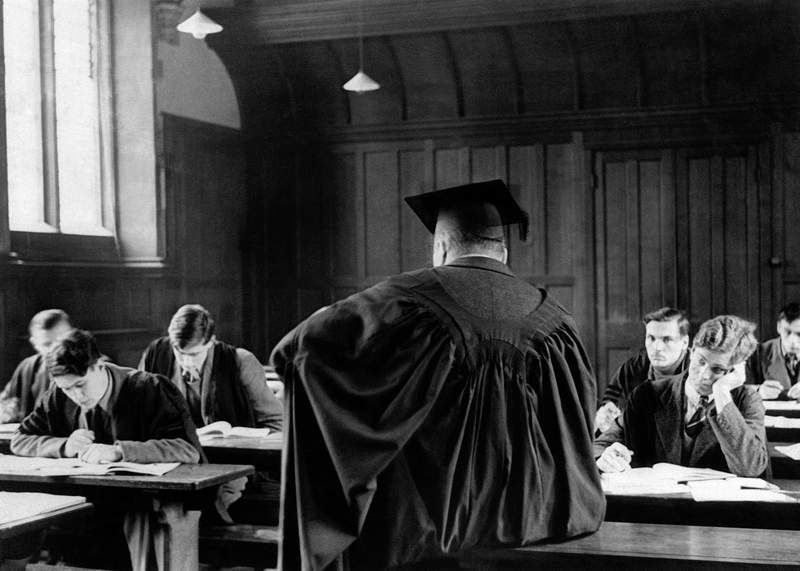 FILE  - In this Dec. 8, 1938 file photo, Cambridge University students sit during a lecture in Cambridge, England. Cambridge has become the first university in Britain to cancel all face-to-face lectures for the 2020-21 academic year because of the coronavirus pandemic, after 800 years welcoming students to its cloisters, quadrangles and classrooms. (AP Photo, File)