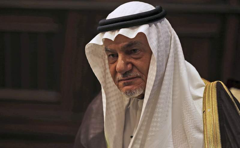 FILE - In this Nov. 24, 2018 file photo, Saudi Prince Turki al-Faisal talks to The Associated Press in Abu Dhabi, United Arab Emirates. Turki harshly criticized Israel on Sunday, Dec. 6, 2020, at a Bahrain security summit that was remotely attended by Israel's foreign minister. (AP Photo/Kamran Jebreili, File)