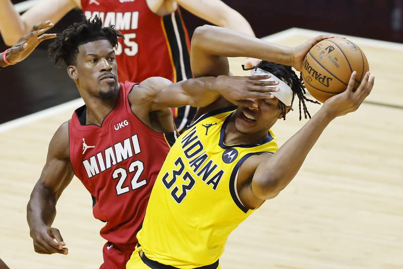 Jimmy Butler of the Miami Heat defends Myles Turner of the Indiana Pacers during the third quarter at American Airlines Arena on March 19, 2021 in Miami, Florida.