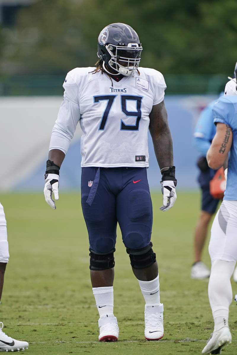 Tennessee Titans offensive tackle Isaiah Wilson gets set to run a drill during NFL football training camp Friday, Aug. 28, 2020, in Nashville, Tenn. (AP Photo/Mark Humphrey, Pool)
