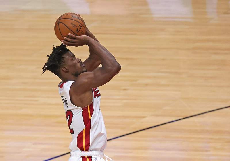 Jimmy Butler of the Miami Heat shots against the Chicago Bulls at the United Center on March 12, 2021 in Chicago, Illinois.