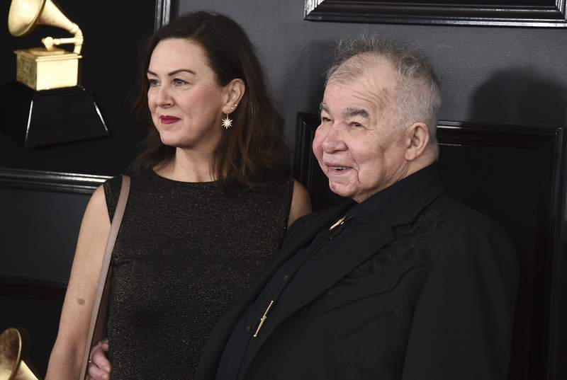 FILE - In this Feb. 10, 2019 file photo, Fiona Whelan Prine, left, and John Prine arrive at the 61st annual Grammy Awards in Los Angeles. The wife of the late celebrated singer-songwriter John Prine, who died from complications of COVID-19, is urging lawmakers to expand absentee voting so Tennesseans would not have to put their health at risk exercising their right to vote. Fiona Whelan Prine told a Senate panel Tuesday that allowing more people to cast an absentee ballot was critical in ensuring that people would remain safe and healthy during the 2020 election. Whelan Prine also contracted the coronavirus, but she has since recovered. (Photo by Jordan Strauss/Invision/AP, File)