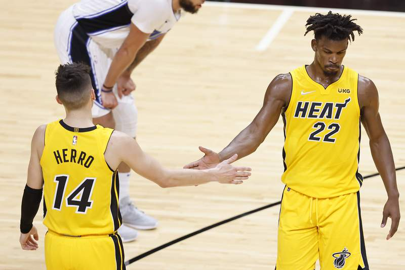 Jimmy Butler of the Miami Heat celebrates with Tyler Herro against the Orlando Magic during the second quarter at American Airlines Arena on March 11, 2021 in Miami, Florida.