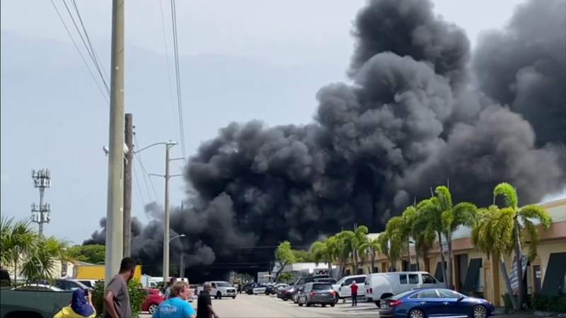 Foam manufacturing warehouse catches fire sending black smoke billowing into the air