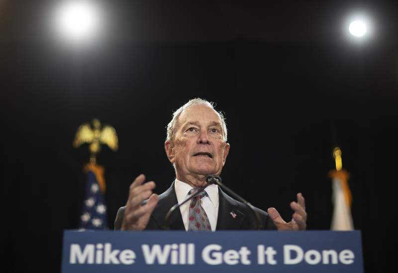 FILE - In this Feb. 5, 2020, file photo, then-Democratic presidential candidate and former New York City Mayor Michael Bloomberg speaks at a campaign event in Providence, R.I. Bloomberg has come through on his vow to spend whatever it takes to defeat President Donald Trump. The former presidential candidate has pledged to spend $100 million in Florida to boost Joe Biden there. (AP Photo/David Goldman, File)