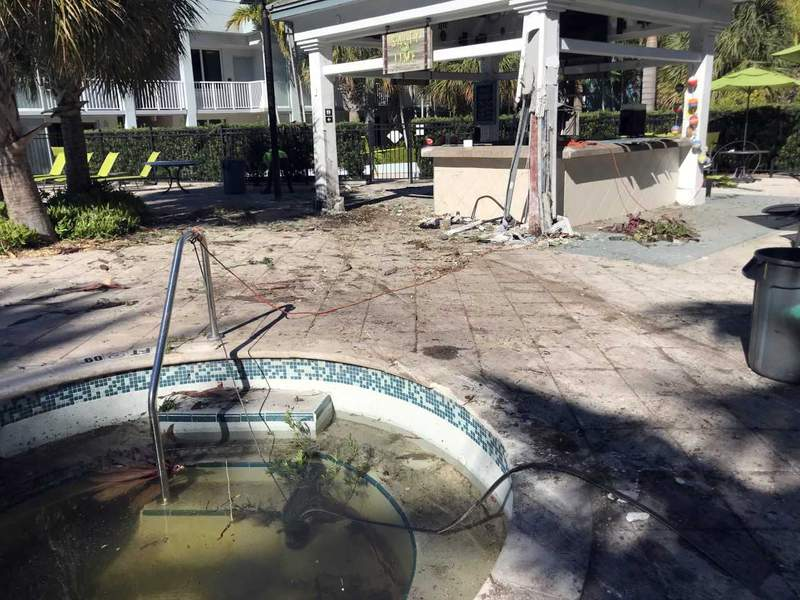 A man in Key West smashed into a hotel pool area after being on the run from police.