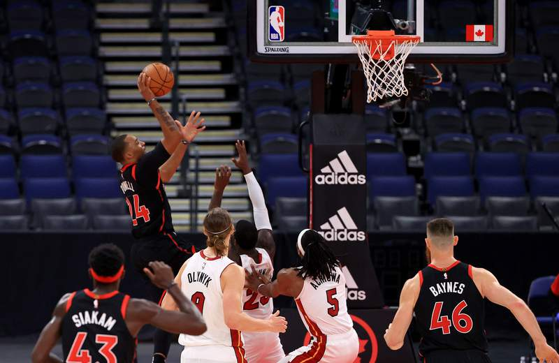 Norman Powell of the Toronto Raptors shoots during a game against the Miami Heat at Amalie Arena on January 22, 2021 in Tampa, Florida.