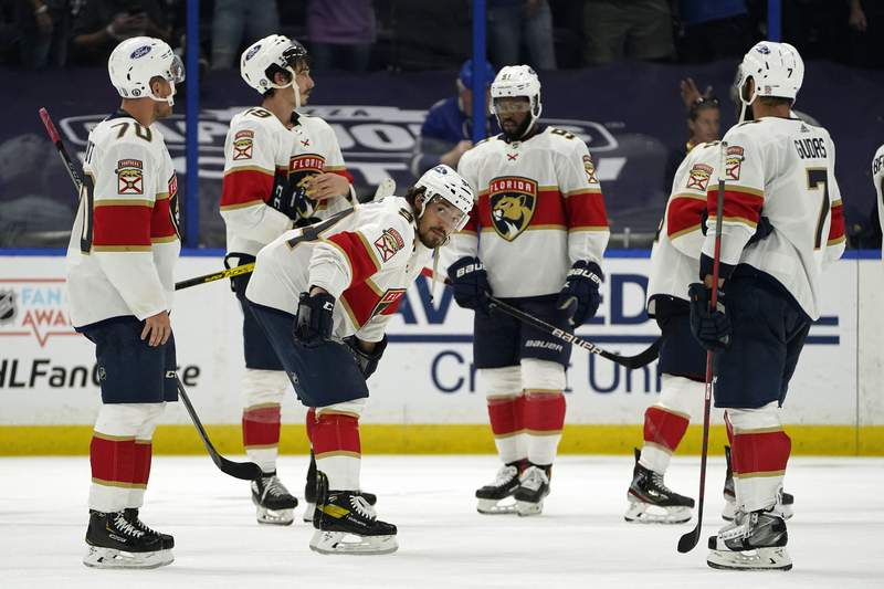 Members of the Florida Panthers react after being eliminated by the Tampa Bay Lightning during Game 6 of an NHL hockey Stanley Cup first-round playoff series Wednesday, May 26, 2021, in Tampa, Fla.