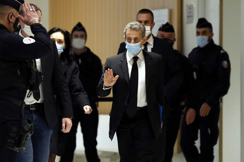 Former French President Nicolas Sarkozy arrives at the courtroom Monday, Dec. 7, 2020 in Paris. Sarkozy goes on trial on charges of corruption and influence peddling in a phone-tapping scandal, a first for the 65-year-old politician who has faced several other judicial investigations since leaving office in 2012. (AP Photo/Thibault Camus)