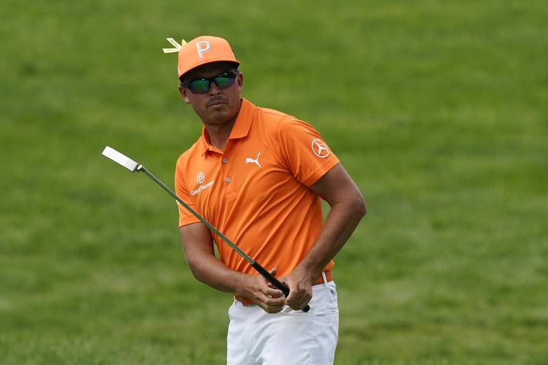 Rickie Fowler watches his putt on the first hole during the final round of the Memorial golf tournament, Sunday, June 6, 2021, in Dublin, Ohio. (AP Photo/Darron Cummings)
