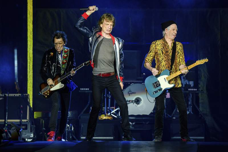 """Ronnie Wood, from left, Mick Jagger and Keith Richards of the Rolling Stones perform during the """"No Filter"""" tour at The Dome at America's Center, Sunday, Sept. 26, 2021, in St. Louis."""