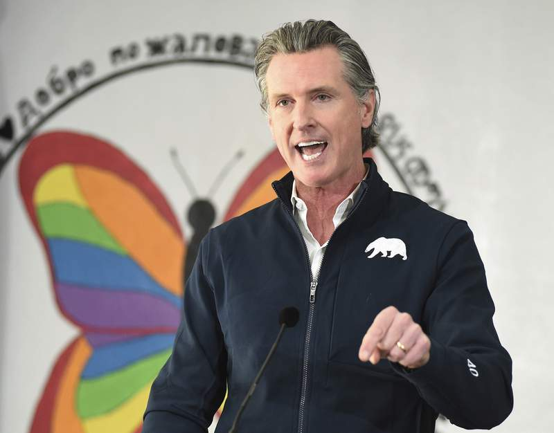 FILE - In this Feb. 26, 2021, file photo, California Gov. Gavin Newsom speaks during a press conference, after visiting a COVID-19 vaccination clinic for farmworkers at the Dr. Sharon Stanley-Rea Community Center in Fresno, Calif.  Gov. Newsom is set to give perhaps the most important speech of his political life Tuesday, March 9, and hes spent weeks laying the groundwork for an upbeat address aimed at nearly 40 million people exhausted by a year of coronavirus restrictions. (John Walker/The Fresno Bee via AP, File)