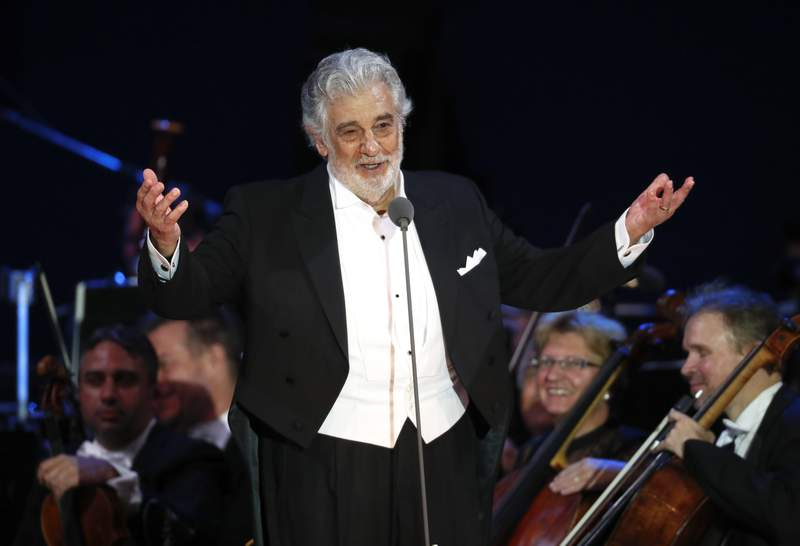FILE - In this Aug. 28, 2019 file photo, opera star Placido Domingo salutes spectators at the end of a concert in Szeged, Hungary. The Spanish government on Wednesday Feb. 26, 2020 has decided to cancel the participation of tenor Placido Domingo in Madrid's La Zarzuela opera theater in May 2020 in light of the latest developments in the sexual misconduct allegations against the legendary singer. (AP Photo/Laszlo Balogh, File)