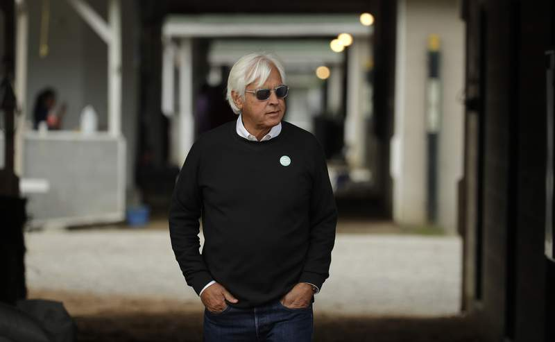 FILE - In this Wednesday, May 1, 2019, file photo, trainer Bob Baffert looks out from his barn before a workout at Churchill Downs in Louisville, Ky. Two-time Triple Crown-winning trainer Baffert has been suspended for 15 days by the Arkansas Racing Commission after two of his horses tested positive for a banned substance. The commission says in a ruling that the suspension runs from Aug. 1 to Aug. 15, 2020. (AP Photo/Charlie Riedel, File)