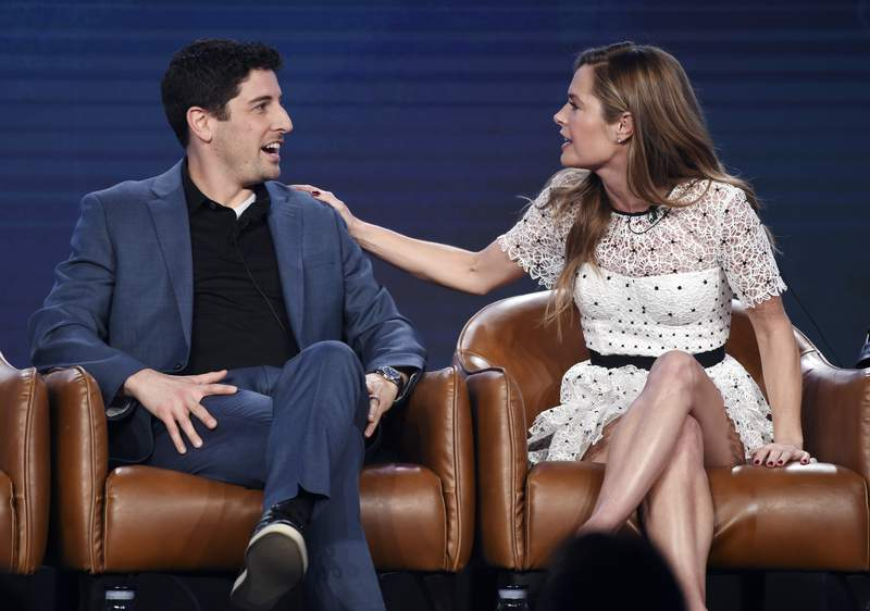 """Jason Biggs, left, and Maggie Lawson, cast members in the upcoming television series """"Outmatched,"""" interact onstage during the 2020 FOX Television Critics Association Winter Press Tour, Tuesday, Jan. 7, 2020, in Pasadena, Calif. (AP Photo/Chris Pizzello)"""
