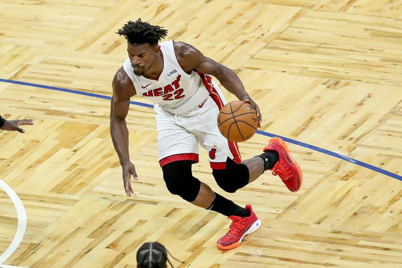 Jimmy Butler of the Miami Heat drives against the Orlando Magic during the second half at Amway Center on March 14, 2021 in Orlando, Florida.