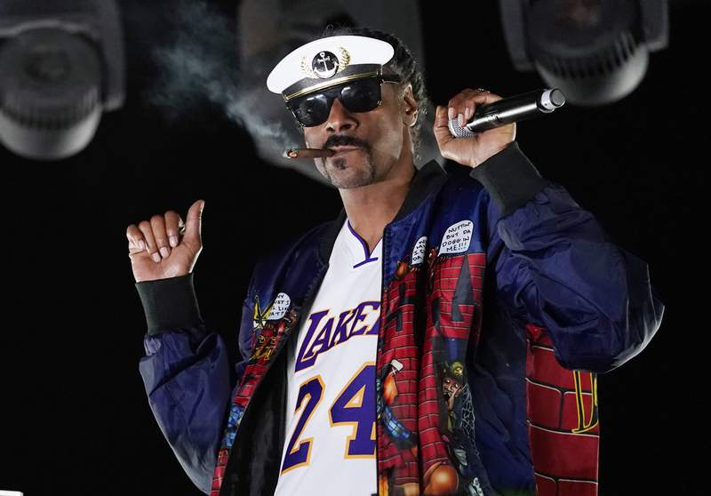 """FILE - Snoop Dogg performs a DJ set as """"DJ Snoopadelic"""" during the """"Concerts In Your Car"""" series on Oct. 2, 2020, in Ventura, Calif.  The rapper will join Def Jam Recordings as an executive creative and strategic consultant. (AP Photo/Chris Pizzello, File)"""