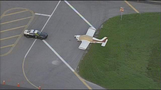 A small plane that made an emergency landing on U.S. Route 27 remained on the side of the highway Wednesday morning, guarded by a Florida Highway Patrol trooper.
