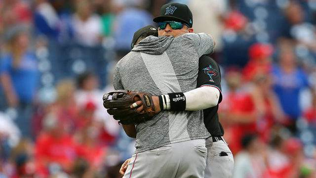 Martin Prado #14 of the Miami Marlins is hugged by Starlin Castro #13 after he was removed from the game during the ninth inning against the Philadelphia Phillies. (Photo by Rich Schultz/Getty Images)