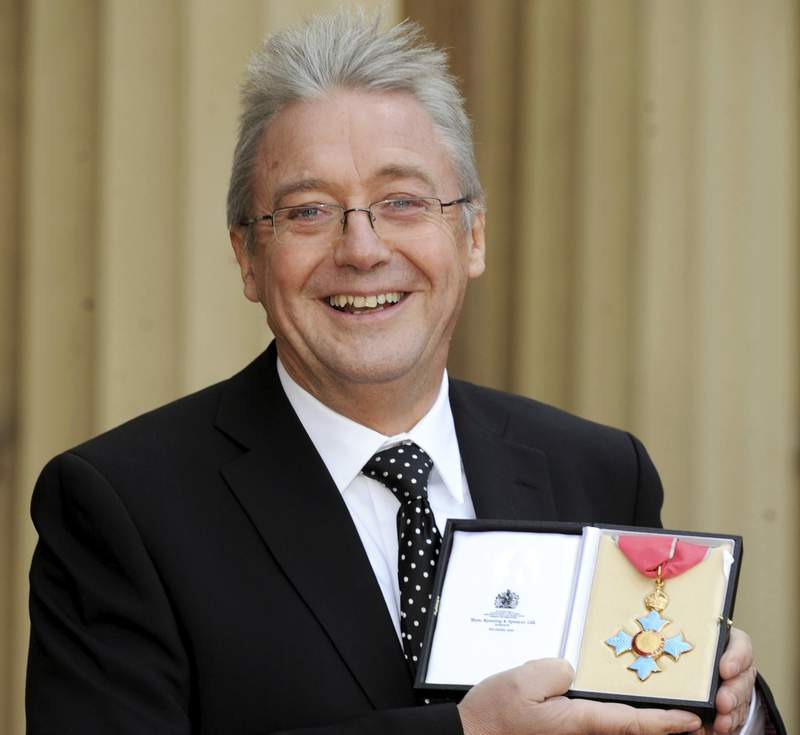"""FILE - In this file photo dated Nov. 27, 2009,  opera director Graham Vick poses outside Buckingham Palace in London. Vick died Saturday following """"complications arising from Covid-19,""""  the Birmingham Opera Company announced, Sunday July 18, 2021.  (Anthony Devlin/PA via AP)"""