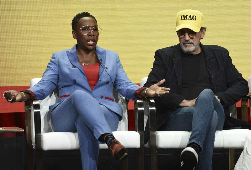 """Gina Yashere, left, producer of the CBS series """"Bob Hearts Abishola,"""" and executive producer Chuck Lorre take part in a panel discussion on the show during the Summer 2019 Television Critics Association Press Tour at the Beverly Hilton, in a Thursday, Aug. 1, 2019 file photo, in Beverly Hills, Calif. A memoir by the comedian, writer and producer and actor Gina Yashere is called Cack-Handed and comes out June 8, 2020. Amistad made the announcement Monday, Sept. 21, 2020.  (Photo by Chris Pizzello/Invision/AP)"""