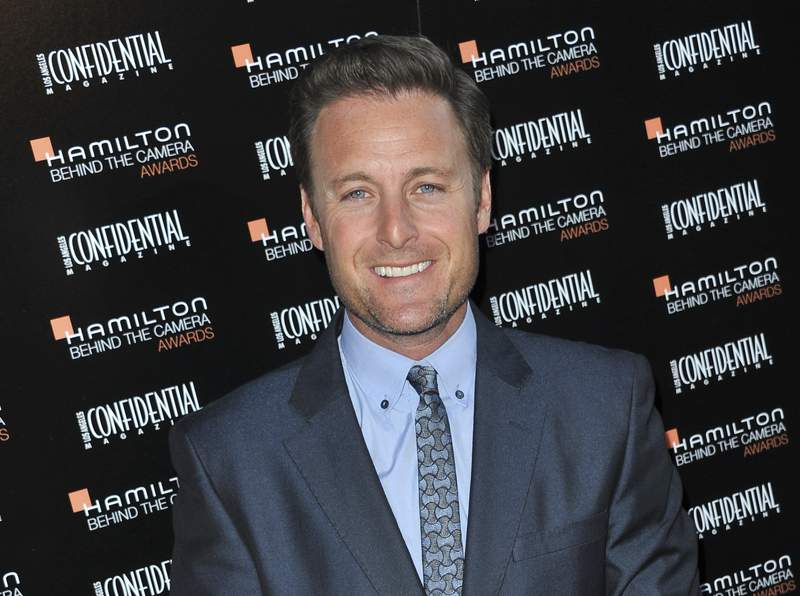 """FILE - This Oct. 28, 2012 file photo shows Chris Harrison at the Hamilton """"Behind the Camera"""" Awards at the House of Blues West Hollywood, Calif.  Chris Harrison, host of The Bachelor, says he is stepping down from his TV role and is ashamed for his handling of a swirling racial controversy at the ABC dating show. In a new statement posted Saturday, Feb. 13, 2021 Harrison apologized again for defending the actions by a contestant that many consider offensive.(Photo by Richard Shotwell/Invision/AP, File)"""
