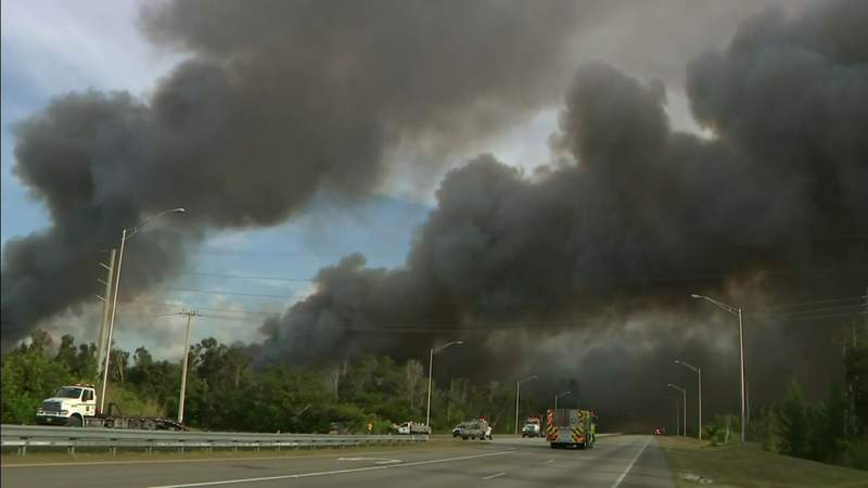 Large brush fire continues burning in west Miami-Dade