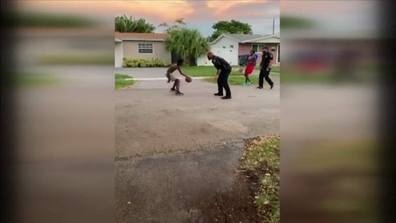 Officers join Hollywood teens playing basketball, turning one-on-one game into two-on-two