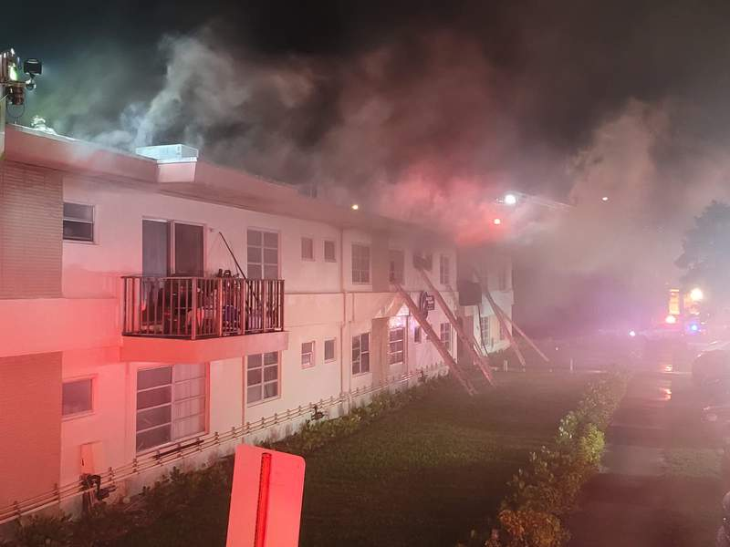 Firefighters battle a blaze in Northeast Miami-Dade Sunday.
