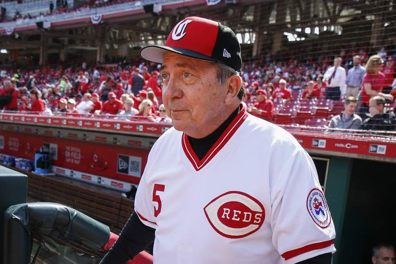 File-This March 28, 2019, file photo shows Cincinnati Reds hall of fame catcher Johnny Bench walking up to the field before an opening day baseball game against the Pittsburgh Pirates in Cincinnati.  The winning bidder on over $1 million worth of memorabilia from a recent auction of Johnny Bench's personal collection is returning the items to the Hall of Fame catcher, with whom he's been friends since 1967. Businessman Alan Horwitz, a super fan of the Philadelphia 76ers who sits courtside at home games wearing his Sixth Man jersey, successfully bid for Bench's 1975 and 76 World Series rings last month. He also bought the catcher's 1970 and 72 NL MVP awards, 1968 NL rookie of the year award, 1969 All-Star Game bat, and several of Bench's 10 Gold Glove awards. (AP Photo/Gary Landers, File)