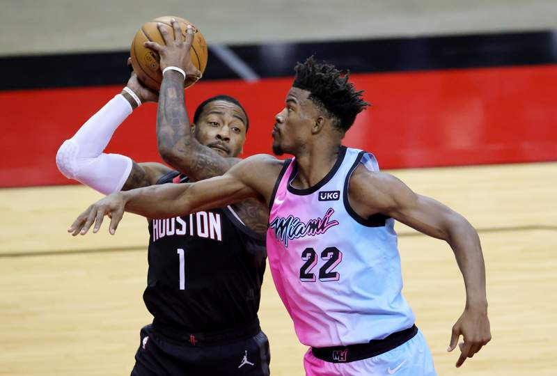 John Wall of the Houston Rockets controls the ball against Jimmy Butler of the Miami Heat during the second quarter at the Toyota Center on February 11, 2021 in Houston, Texas.