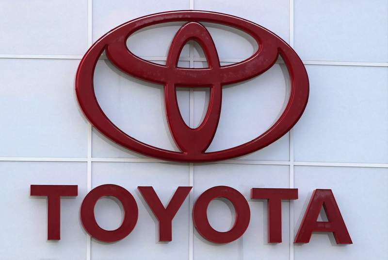 This Aug. 15, 2019, file photo shows the Toyota logo on a dealership in Manchester, N.H. In a deal announced Wednesday, July 21, 2021, Japans top automaker Toyota is adding makers specializing in tiny kei cars, Daihatsu and Suzuki, to a partnership in commercial vehicles set up with Hino and Isuzu earlier this year. (AP Photo/Charles Krupa, File)