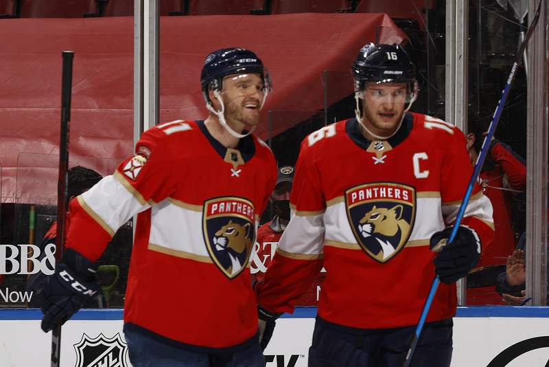 Jonathan Huberdeau celebrates his third period goal with Aleksander Barkov of the Florida Panthers against the Chicago Blackhawks at the BB&T Center on January 17, 2021 in Sunrise, Florida.