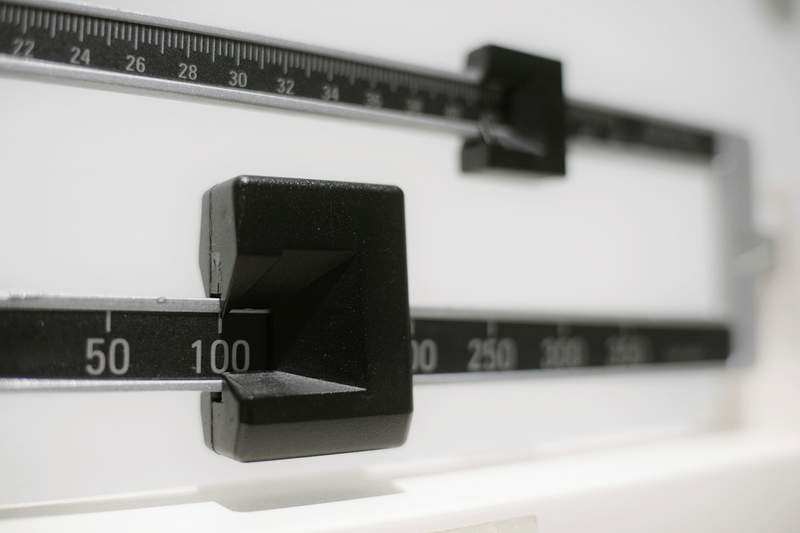 This Tuesday, April 3, 2018 file photo shows a closeup of a beam scale in New York. A study by the U.S. Centers for Disease Control and Prevention released on Thursday, Sept. 16, 2021, ties the COVID-19 pandemic to an alarming increase in obesity in U.S. children and teenagers. (AP Photo/Patrick Sison, File)