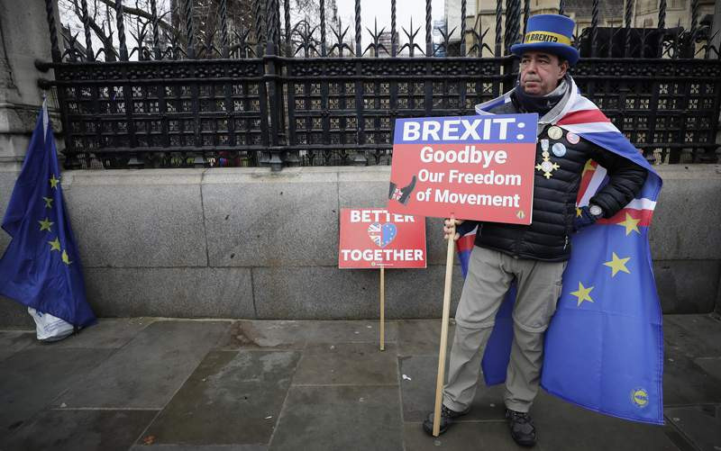 Anti-Brexit campaigner Steve Bray holds banners as he stands outside Parliament in London, Thursday, Jan. 30, 2020. Although Britain formally leaves the European Union on Jan. 31, little will change until the end of the year. Britain will still adhere to the four freedoms of the tariff-free single market  free movement of goods, services, capital and people. (AP Photo/Kirsty Wigglesworth)