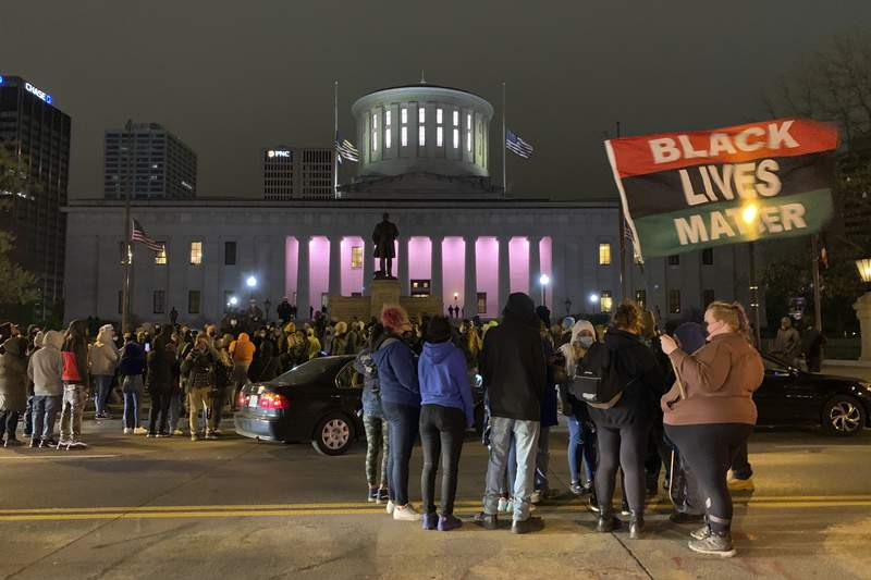 A crowd gathers in front of the Ohio Statehouse during a  protest Tuesday, April 20, 2021, in Columbus, Ohio. Earlier Tuesday, police shot and killed a teenage girl in Columbus just as the verdict was being announced in the trial for the killing of George Floyd. Police showed bodycam footage Tuesday night at a news conference of the officer shooting the girl, who was Black, as she appeared to attempt to stab two people with a knife. (AP Photo/Jay LaPrete)