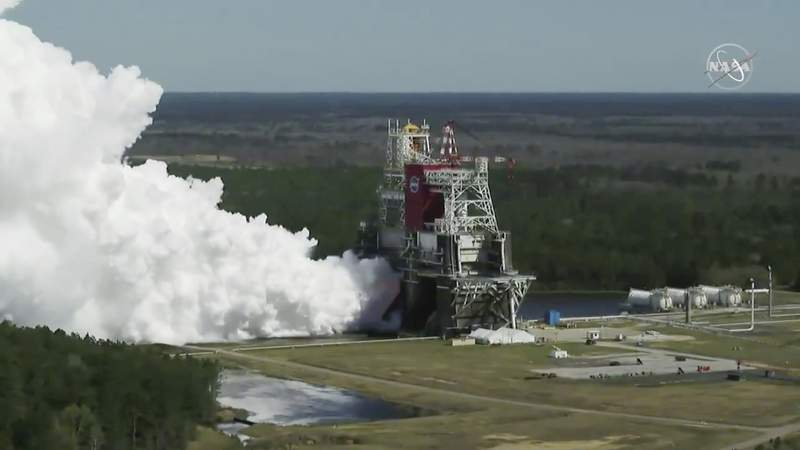 In this image from video made available by NASA, the core stage of the Space Launch System, NASAs planned moon rocket, is tested at the Stennis Space Center near Bay St. Louis, Miss., on Thursday, Mar. 18, 2021. With this critical test finally finished, NASA now will send the rocket segment to Kennedy Space Center for launch preparations. (NASA via AP)